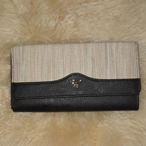 Handbags - 5/25. NWOT Cute trifold tan and black wallet.